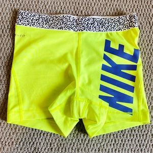 2 Nike shorts (neon yellow and purple)